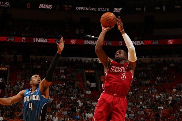 James' jumper lifts Heat over Magic, 101-99