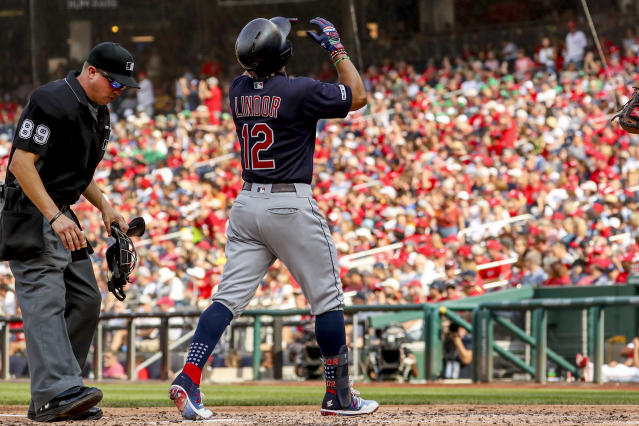 Cleveland Indians Francisco Lindor (12) scores on a solo home run during the third inning of a baseball game against the Washington Nationals at Nationals Park, Sunday, Sept. 29, 2019, in Washington. (AP Photo/Andrew Harnik)