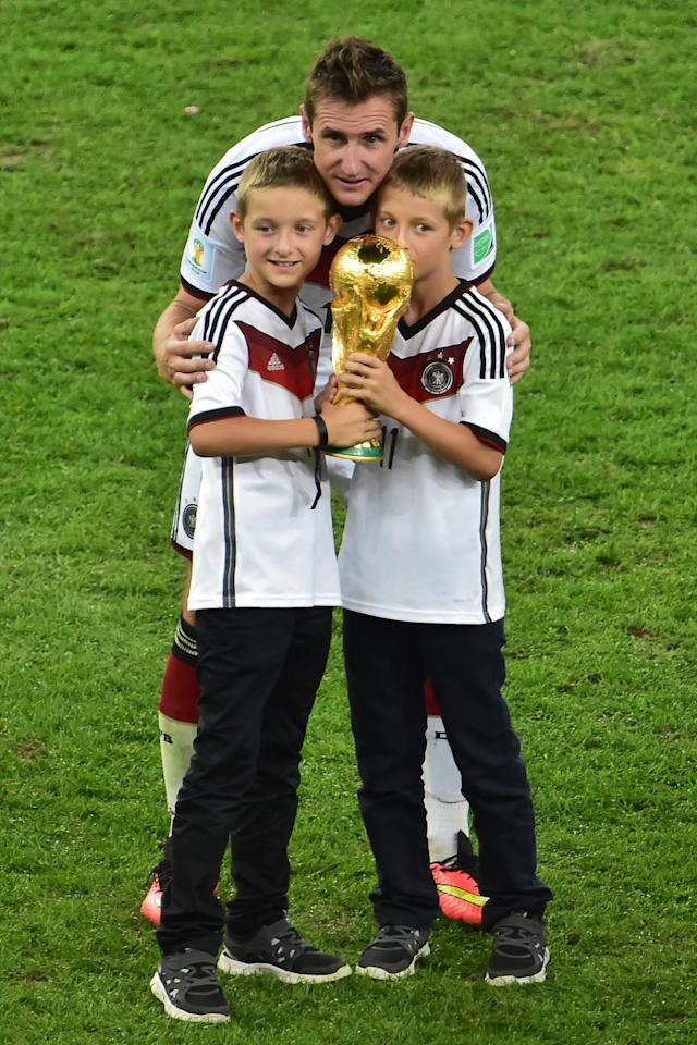 Germany's forward Miroslav Klose (C) celebrates with his sons after winning the 2014 FIFA World Cup final football match between Germany and Argentina at the Maracana Stadium in Rio de Janeiro on July 13, 2014 (AFP Photo/Nelson Almeida)