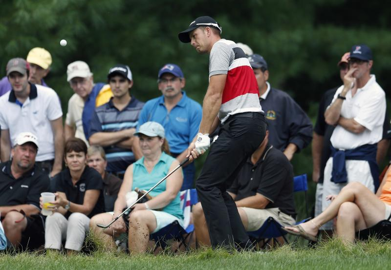 Henrik Stenson, of Sweden, chips from the rough on to the fifth green during the third round of the Deutsche Bank Championship golf tournament in Norton, Mass., Sunday, Sept. 1, 2013. (AP Photo/Michael Dwyer)