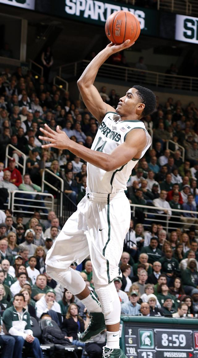 Michigan State's Gary Harris shoots against Indiana during the first half of an NCAA college basketball game, Tuesday, Jan. 21, 2014, in East Lansing, Mich. (AP Photo/Al Goldis)