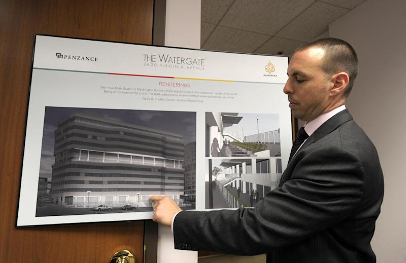 In this photo taken May 30, 2012, Penzance Senior Vice President of Leasing Matthew Pacinelli shows a rendering of the planned renovations for the front of the Watergate Office Building in Washington. Forty years ago police in Washington arrested five men breaking in to the Democratic National Committee offices in Washington. The name of the complex they were breaking into became infamous: the Watergate. These days, though, unless you know where to look, there's little marking the location of the 1972 crime that ultimately led to the resignation of President Richard Nixon. The office building that was the site of the break in is still in use, though the tenants have changed. The adjacent hotel where the burglars stayed is currently closed. And another hotel across the street where a lookout waited with a walkie-talkie, monitoring the burglars' progress, has been turned into a college dorm. (AP Photo/Susan Walsh)