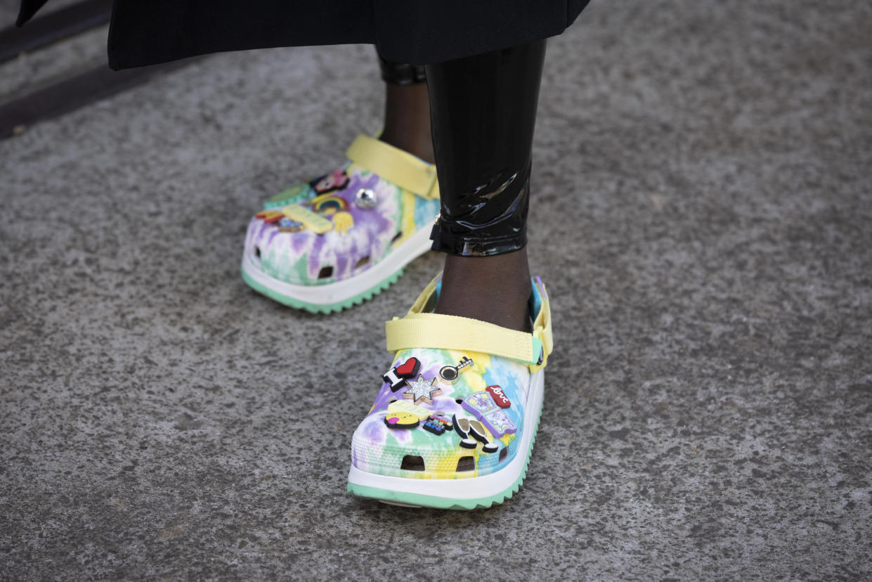 SYDNEY, AUSTRALIA - JUNE 01: Suzan Mutesi is seen wearing Crocs shoes with Jibbitz charms at Afterpay Australian Fashion Week 2021 on June 1, 2021 in Sydney, Australia. (Photo by Matt Jelonek/WireImage)