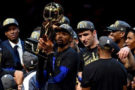 Jun 8, 2018; Cleveland, OH, USA; Golden State Warriors forward Kevin Durant (35) celebrates with the Larry O'Brien Championship Trophy after beating the Cleveland Cavaliers in game four of the 2018 NBA Finals at Quicken Loans Arena. Mandatory Credit: Ken Blaze-USA TODAY Sports