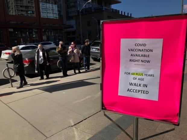A line formed outside a Shoppers Drug Mart in the Yonge-Eglinton neighbourhood on Friday where COVID-19 vaccines were being offered to people aged 60 years and older.  ( - image credit)