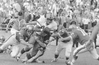 FILE - In this Sept. 12, 1966 file photo, Syracuse's Floyd Little (44) runs down the field despite during a college football game at Baylor Stadium in Waco, Texas. Little, the Hall of Fame running back who starred at Syracuse and for the Denver Broncos, has died. The Pro Football Hall of Fame said he died Friday, Jan. 1, 2021. (AP Photo/FK, File)