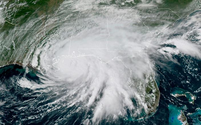 This GOES-16 GeoColor satellite image taken on Tuesday shows Hurricane Sally moving slowly towards the coast from the Gulf of Mexico - NOAA via AP