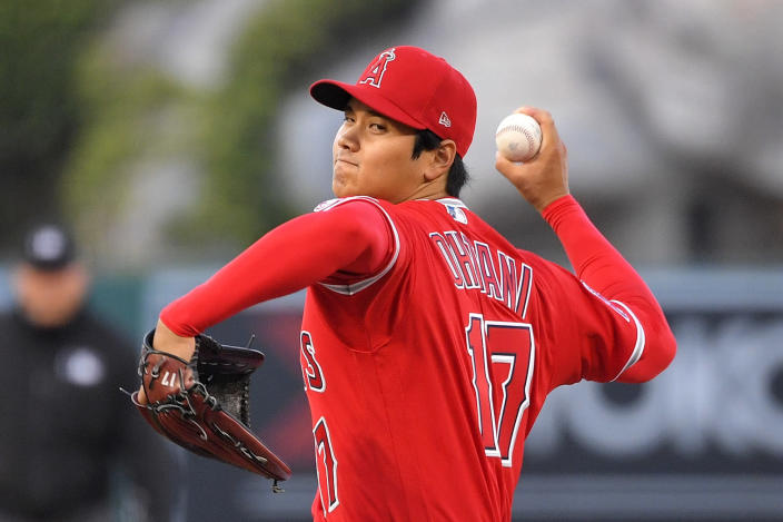 Los Angeles Angels designated hitter Shohei Ohtani throws to the plate during the first inning of a baseball game against the Texas Rangers Tuesday, April 20, 2021, in Anaheim, Calif. (AP Photo/Mark J. Terrill)
