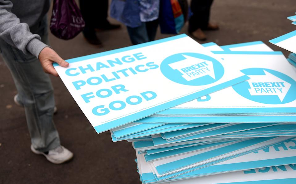 People take away Brexit Party placards after a rally in Clacton-on-Sea, Essex (Picture: PA)