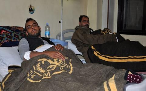 Bashad regime soldiers wounded in the US strikes near Deir Ezzor are seen in a hospital last week - Credit: AFP/Getty Images