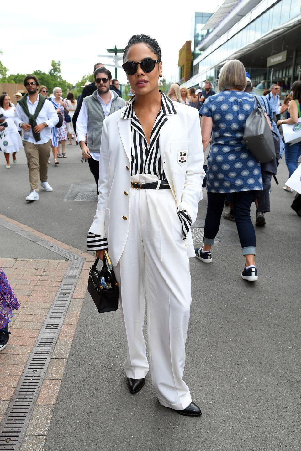 """<p>Fresh from the <a href=""""https://www.elle.com/uk/fashion/g26808945/stylish-celebs/?slide=4"""" rel=""""nofollow noopener"""" target=""""_blank"""" data-ylk=""""slk:front row of Couture Week"""" class=""""link rapid-noclick-resp"""">front row of Couture Week</a>, Tessa Thompson arrived looking as chic as ever in a Polo Ralph Lauren cream suit and pinstripe monochrome shirt.</p>"""
