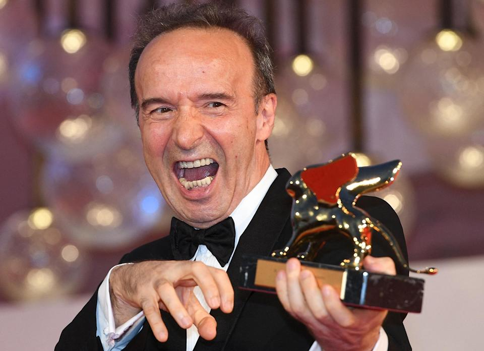 <p>Italian actor and director Roberto Benigni poses for photographers after receiving a Golden Lion for lifetime achievement, following the the opening ceremony of the 78th Venice Film Festival, on Sept. 1.</p>