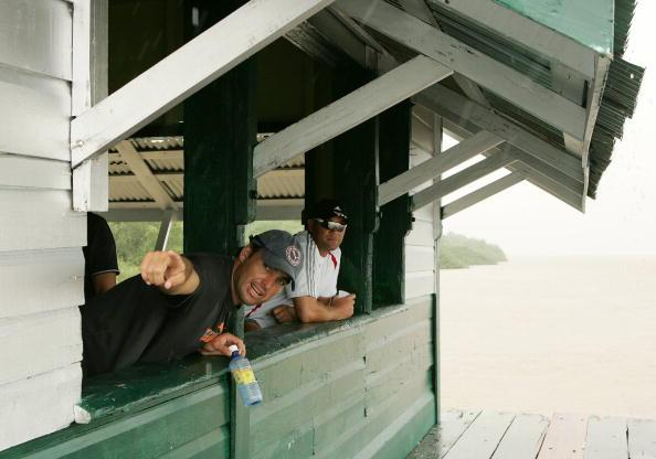 GUYANA, WEST INDIES - APRIL 4: Justin Kemp and Jacques Kallis waiting for the rain to stop on Flag Island during the South Africa Cricket team's open-boat river trip up the Essequibo and Mazaruni Rivers on April 4, 2007 in Guyana, West Indies. (Photo by Duif du Toit/Gallo Images/Getty Images)