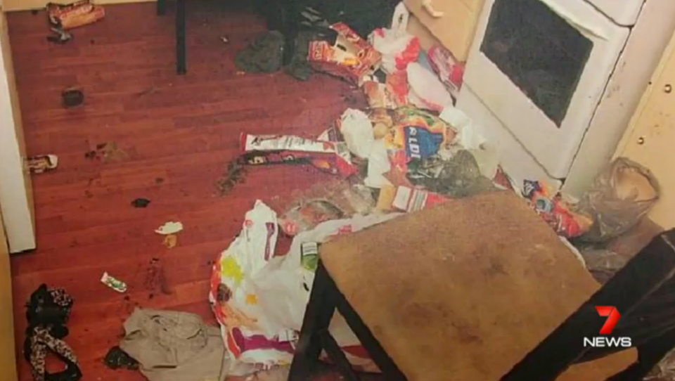 Inside the house of horrors, the pantry is a dirty floor covered in rubbish and rotting food. Photo: 7 News