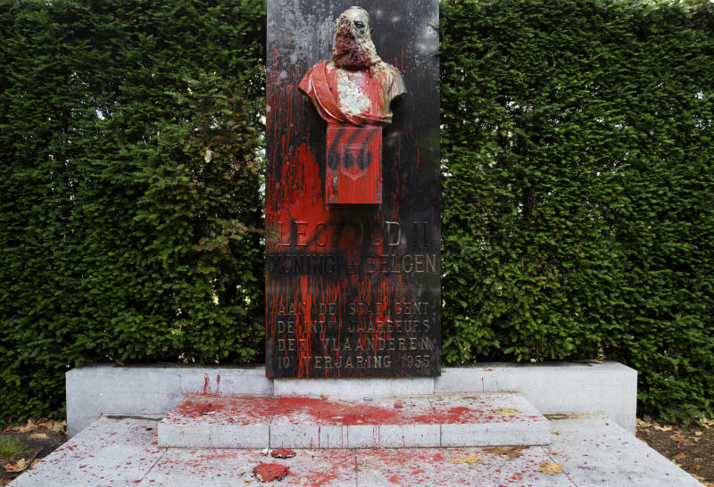 A bust of Belgium's King Leopold II, which has been damaged by red paint, graffiti and cement, at a park in Ghent, Belgium on Friday, June 19, 2020. Protests sweeping the world after George Floyd's death in the U.S. have added fuel to a movement to confront Europe's role in the slave trade and its colonial past. Leopold II is increasingly seen as a stain on the nation where he reigned from 1865 to 1909 with some demonstrators wanting him removed from public view. (AP Photo/Virginia Mayo)