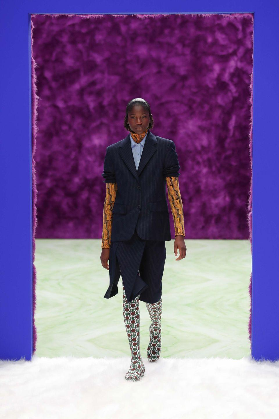 "<p>For Raf Simons and Miuccia Prada's latest collection, the duo decided to focus on change, transformation and opening possibilities.</p><p>""A fusion between disparate themes and intents mirrors the nature of humanity: a belief in the fact that men and women each hold the masculine and feminine within themselves. This collection explores the space that exists between conventional polar opposites – the point between simplicity and complexity, elegance and practicality, limitation and release, transmuted,"" they explained in the show notes.</p><p>This came through with designs that translated from one intent to another, for example with evening gowns in the form of utilitarian jumpsuits and tailored coats in the brightest of colours: ""Ornament can become functional, the pragmatic can become decorative.""</p><p><a href=""https://www.youtube.com/watch?v=yKw39s55vOM&feature=youtu.be"" rel=""nofollow noopener"" target=""_blank"" data-ylk=""slk:Watch the show and see the full collection here"" class=""link rapid-noclick-resp"">Watch the show and see the full collection here</a>.</p>"
