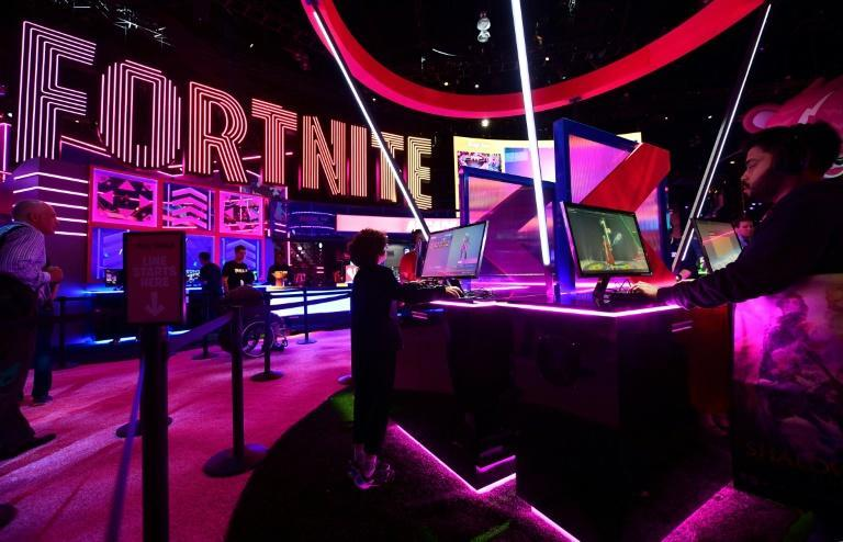 """Gaming fans play """"Fortnite"""" at the 2019 Electronic Entertainment Expo, also known as E3, on June 11, 2019"""