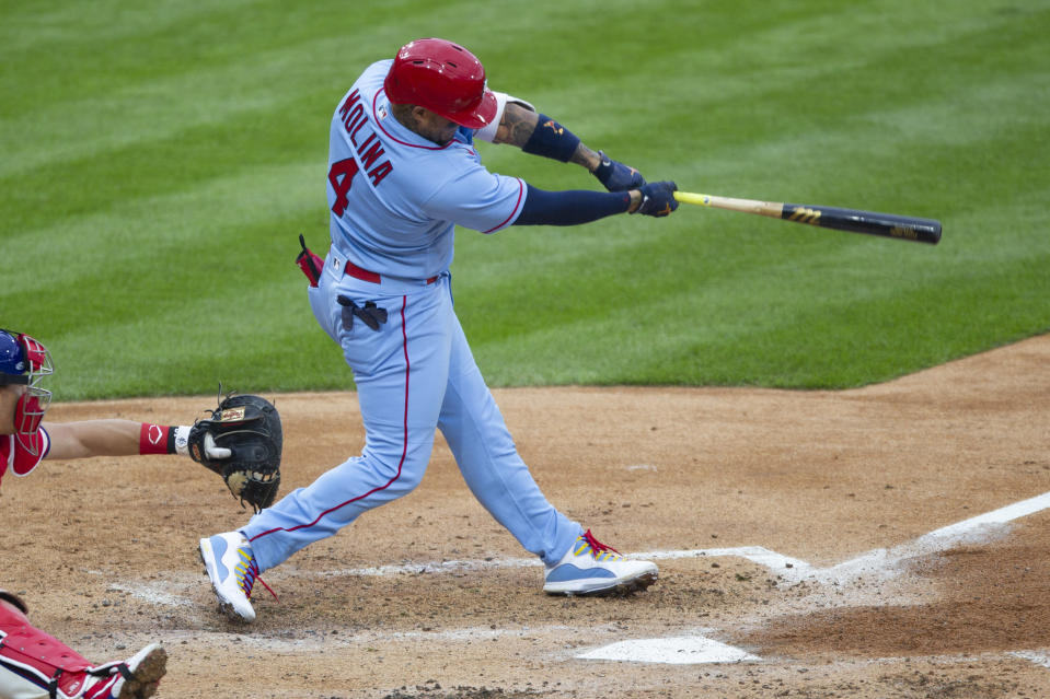CORRECTS TO THIRD INNING-St. Louis Cardinals' Yadier Molina (4) hits a three-run homer during the third inning of a baseball game against the Philadelphia Phillies, Saturday, April 17, 2021, in Philadelphia. (AP Photo/Laurence Kesterson)