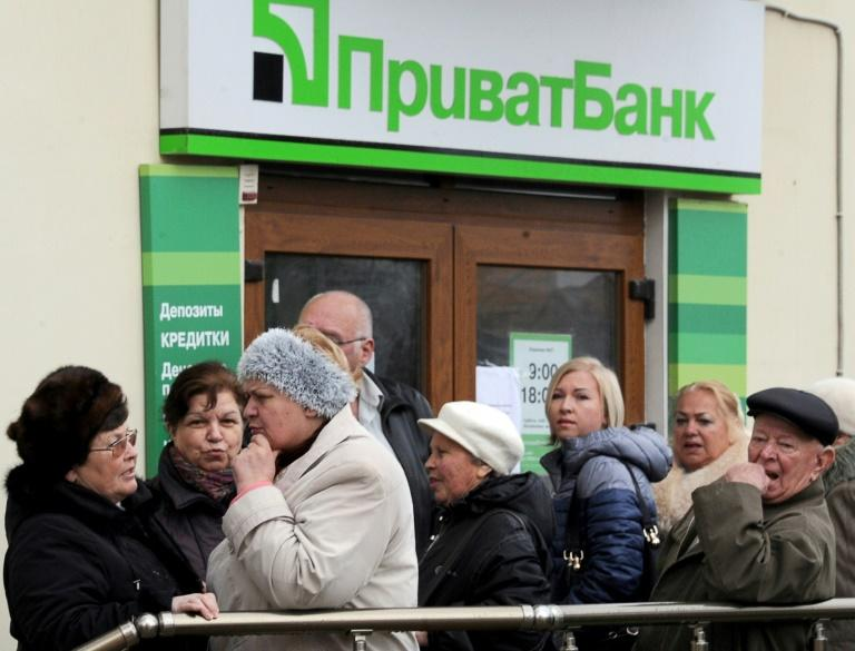 Ukraine declares largest lender insolvent, readies support