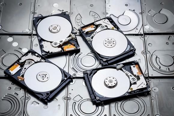 Four disassembled HDDs.