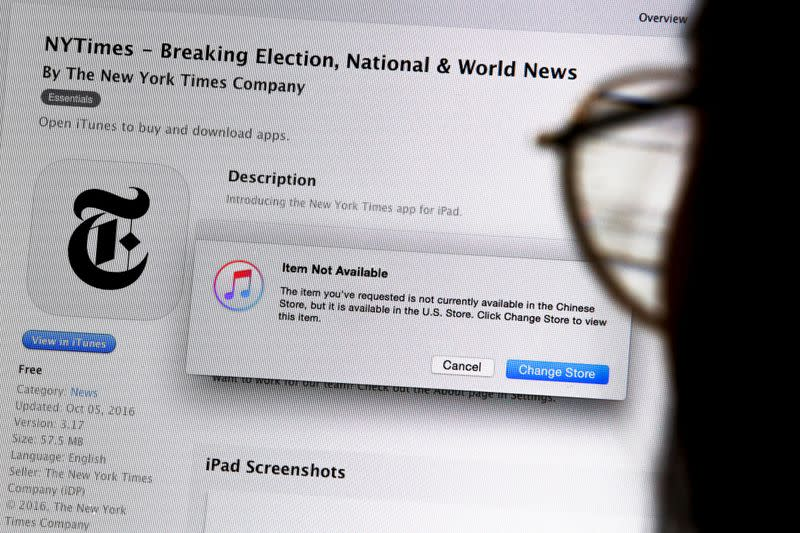 An illustration shows a person looking at a computer screen in Beijing showing an Apple iTunes store message saying that the New York Times app is not available in the Chinese store