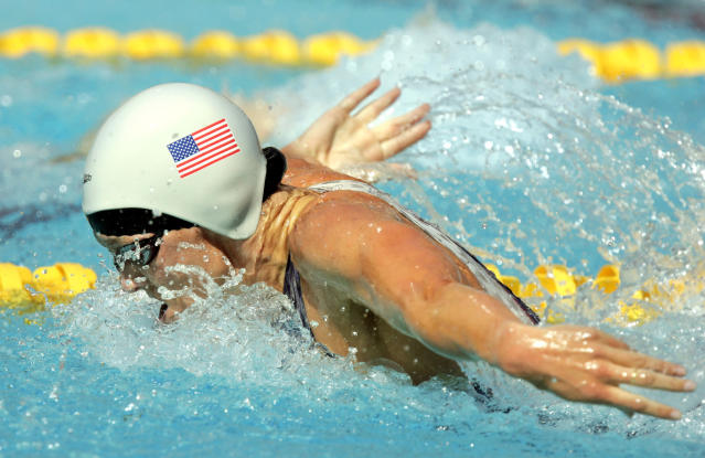FILE - In this Aug. 14, 2004, file photo, Jenny Thompson swims during a qualifying heat of the 100 meter butterfly at the Olympic Aquatic Centre during the 2004 Olympic Games in Athens. One of America's greatest Olympic swimmers, Thompson is now on the front line of the fight against coronavirus as an anesthesiologist at the VA hospital in Charleston, South Carolina. (AP Photo/Mark J. Terrill, File)