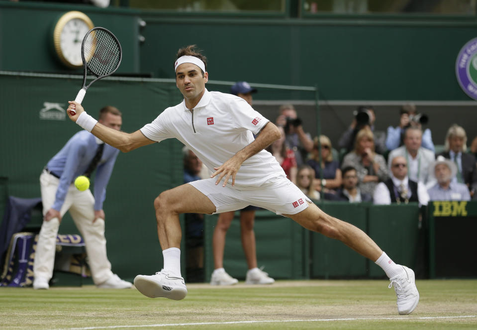 FILE - Switzerland's Roger Federer returns the ball to Serbia's Novak Djokovic during the men's singles final match of the Wimbledon Tennis Championships in London, in this Sunday, July 14, 2019, file photo. The draw to set up the singles brackets for this year's Wimbledon will be held Friday, June 25, 2021. Play begins Monday.(AP Photo/Tim Ireland, File)
