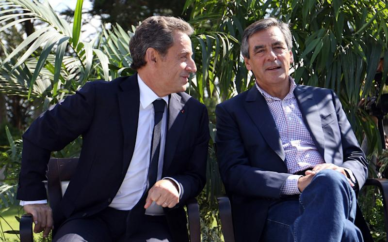 A file picture dated 05 September 2015 shows Nicolas Sarkozy (L) speaking with Francois Fillon (R) - EPA FILE