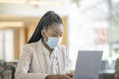 "<span class=""caption"">Some patients may be charged for telehealth sessions they thought were free.</span> <span class=""attribution""><a class=""link rapid-noclick-resp"" href=""https://www.gettyimages.com/detail/photo/young-african-american-woman-with-a-mask-at-work-royalty-free-image/1253388484?adppopup=true"" rel=""nofollow noopener"" target=""_blank"" data-ylk=""slk:FatCamera/GettyImages"">FatCamera/GettyImages</a></span>"