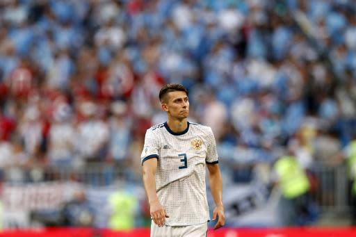 Russia's Ilya Kutepov leaves the pitch after the group A match between Uruguay and Russia at the 2018 soccer World Cup at the Samara Arena in Samara, Russia, Monday, June 25, 2018. Uruguay won 3-0. (AP Photo/Rebecca Blackwell)
