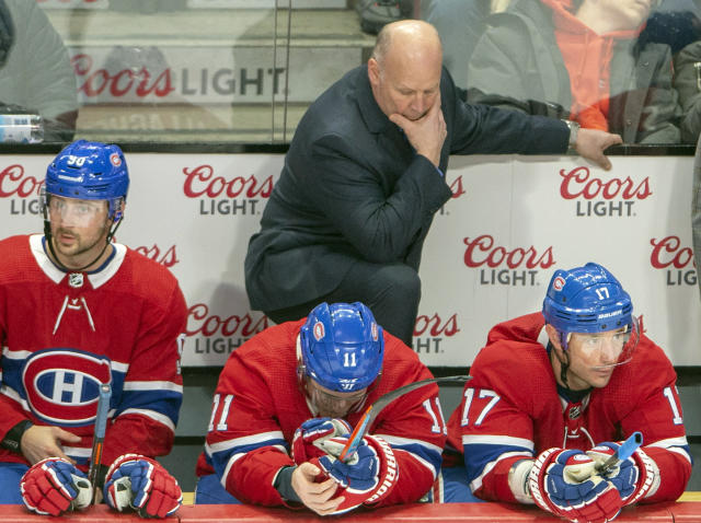 Montreal Canadiens head coach Claude Julien, top, and players Tomas Tatar (90), Brendan Gallagher (11) and Ilya Kovalchuk (17) react after a penalty call during third-period NHL hockey game action against the Arizona Coyotes, Monday, Feb. 10, 2020, in Montreal. (Ryan Remiorz/The Canadian Press via AP)