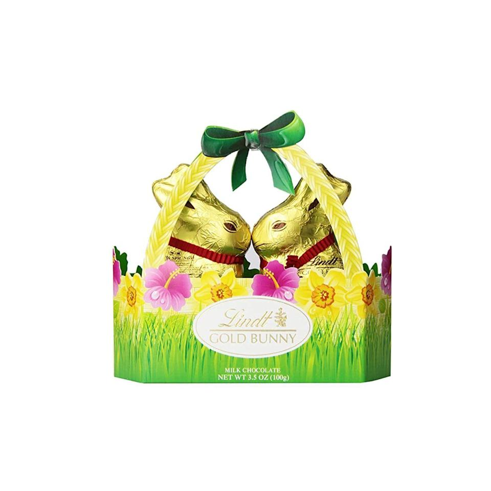 """<p><strong>Lindt</strong></p><p>amazon.com</p><p><strong>$14.96</strong></p><p><a href=""""https://www.amazon.com/dp/B00B96KF8G?tag=syn-yahoo-20&ascsubtag=%5Bartid%7C2164.g.35452335%5Bsrc%7Cyahoo-us"""" rel=""""nofollow noopener"""" target=""""_blank"""" data-ylk=""""slk:Shop Now"""" class=""""link rapid-noclick-resp"""">Shop Now</a></p><p>Skip a step and buy this ready-made basket that comes with two milk chocolate gold bunnies. You can fill it with other goodies, too! </p>"""