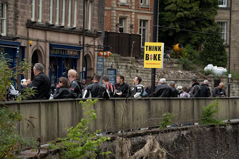 People mill around in Matlock Bath as the parish council leader asked visitors to stay away. (Tom Maddick / SWNS)