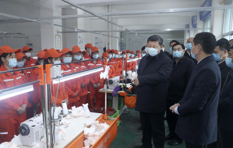 In this April 21, 2020 photo released by China's Xinhua News Agency, Chinese President Xi Jinping wears a face mask as he inspects a factory production line in Laoxian township in Ankang city in northwestern China's Shaanxi Province. (Ju Peng/Xinhua via AP)