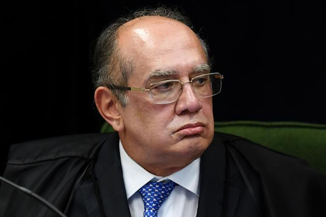 "Brazilian Supreme Court judge Gilmar Mendes attends the trial of senator and Workers' Party president Gleisi Hoffmann for corruption and money laundering, at the Supreme Court in Brasilia, on June 19, 2018. - Hoffmann is the latest in a long string of high-ranking politicians, including many from the Workers' Party, caught up in Brazil's sprawling ""Car Wash"" corruption probe. Prosecutors accuse Hoffmann and husband Paulo Bernardo, a former planning and communications minister, of receiving a million reais in 2010, or 568,000 US dollars at the time, embezzled from state-oil company Petrobras. The money from the company was allegedly used in a campaign slush fund. (Photo by EVARISTO SA / AFP) (Photo credit should read EVARISTO SA/AFP/Getty Images)"