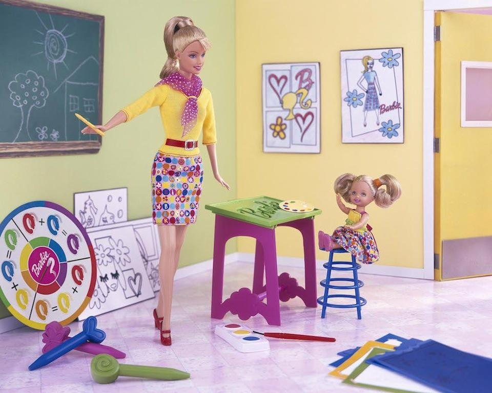 <p>Art Teacher Barbie brings a creative sense of style to the classroom, with a brightly-patterned skirt, fun scarf and a bright red belt that matches her shoes.</p>