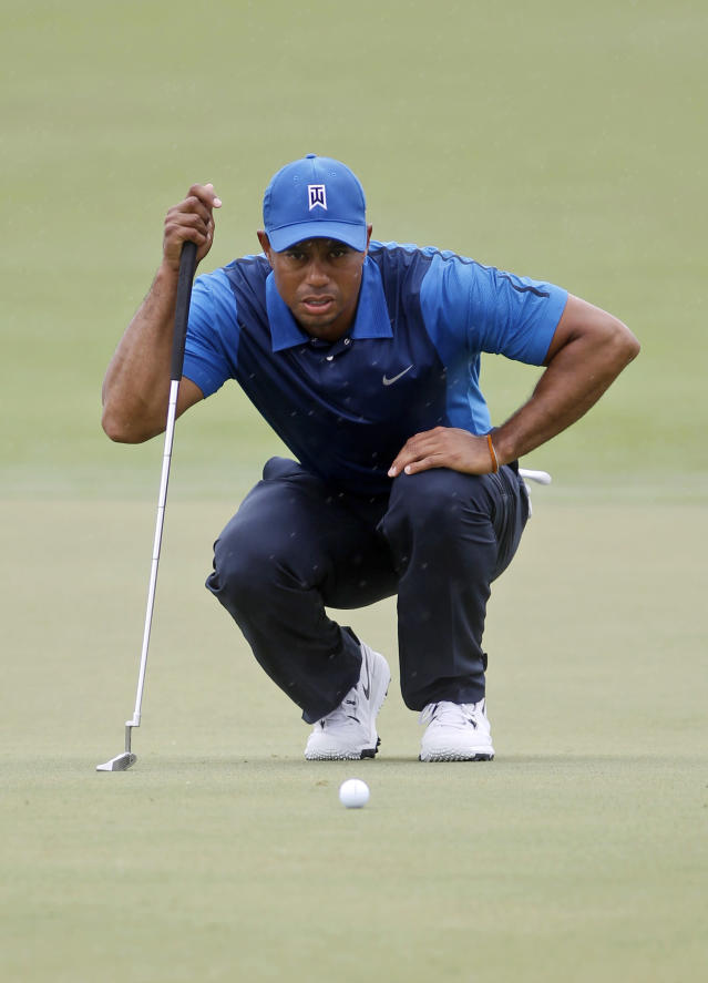 No birdies, but no back issues for Woods