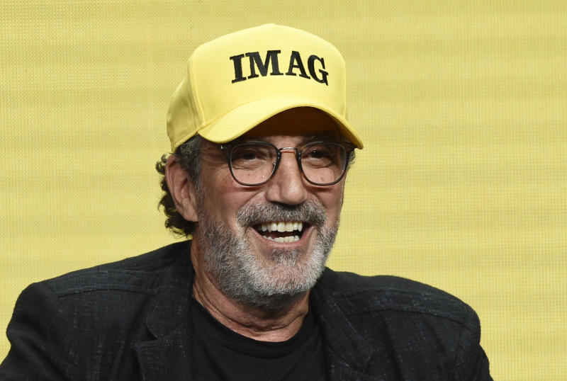 """Chuck Lorre, executive producer of the CBS series """"Bob Hearts Abishola,"""" wears a hat with initials that he said stand for """"Immigrants Make America Great"""" during a panel discussion on the show at the Summer 2019 Television Critics Association Press Tour at the Beverly Hilton, Thursday, Aug. 1, 2019, in Beverly Hills, Calif. (Photo by Chris Pizzello/Invision/AP)"""