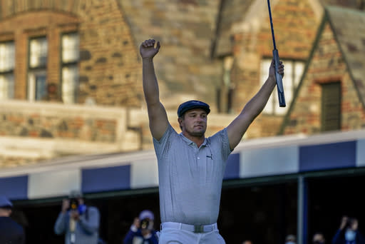 The Latest: DeChambeau bombs away, pulls away to win US Open