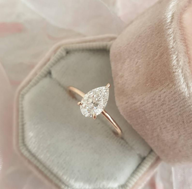 """<p>How could they say no to this <a href=""""https://www.popsugar.com/buy/102-Carat-Pear-Shape-Solitaire-Diamond-Ring-14k-Rose-Gold-531221?p_name=1.02%20Carat%20Pear%20Shape%20Solitaire%20Diamond%20Ring%20in%2014k%20Rose%20Gold&retailer=etsy.com&pid=531221&price=3%2C600&evar1=fab%3Aus&evar9=44555978&evar98=https%3A%2F%2Fwww.popsugar.com%2Fphoto-gallery%2F44555978%2Fimage%2F47011770%2F102-Carat-Pear-Shape-Solitaire-Diamond-Ring-in-14k-Rose-Gold&list1=wedding%2Cjewelry%2Crose%20gold%2Cengagement%20rings&prop13=api&pdata=1"""" rel=""""nofollow noopener"""" class=""""link rapid-noclick-resp"""" target=""""_blank"""" data-ylk=""""slk:1.02 Carat Pear Shape Solitaire Diamond Ring in 14k Rose Gold"""">1.02 Carat Pear Shape Solitaire Diamond Ring in 14k Rose Gold</a> ($3,600)?</p>"""