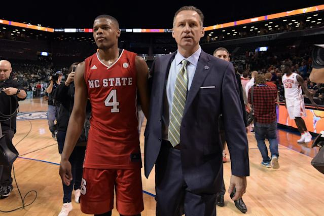 Dennis Smith Jr. and Mark Gottfried walk off after an NC State game during the 2017 ACC tournament. (Getty)