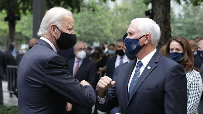 Mr Biden (left) and Mr Pence greeted each other in New York City