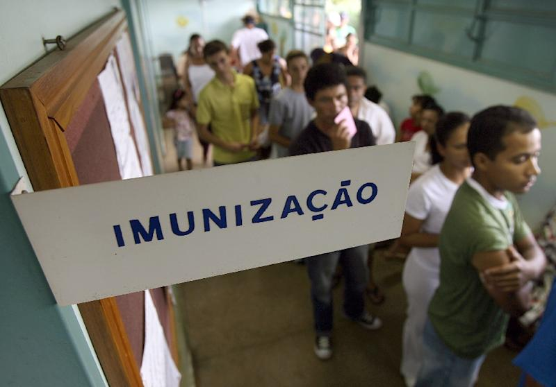 Residents of Brasilia line up to be immunized against yellow fever in January 2008