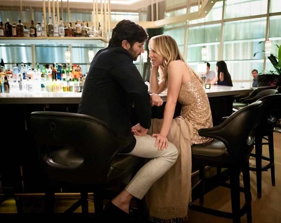 """Cassie Bowden (Kaley Cuoco) shares an intimate moment with Alex (Michiel Huisman), a passenger she met on a flight, in HBO Max's' """"The Flight Attendant."""""""