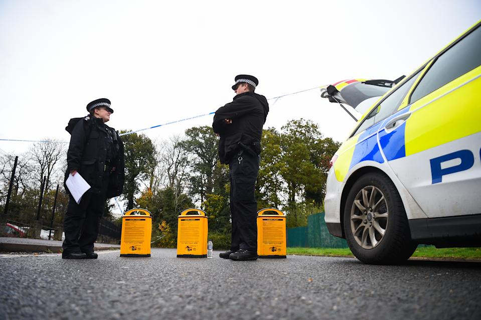 Police officers at the scene on Russell Way in Crawley, West Sussex, after a 24-year-old man was fatally stabbed on Tuesday night.