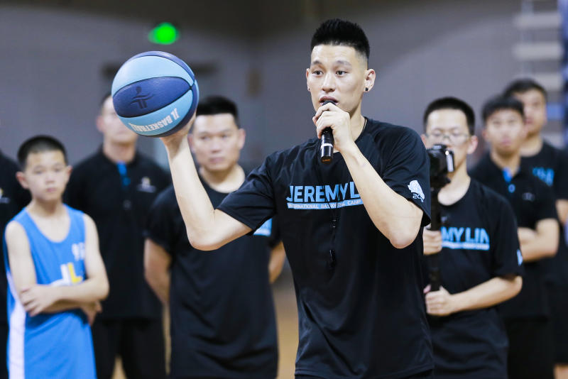 GUANGZHOU, CHINA - AUGUST 07: NBA player Jeremy Lin of the Toronto Raptors plays basketball with children during a basketball camp at Nansha gymnasium on August 7, 2019 in Guangzhou, Guangdong Province of China. (Photo by VCG/VCG via Getty Images)