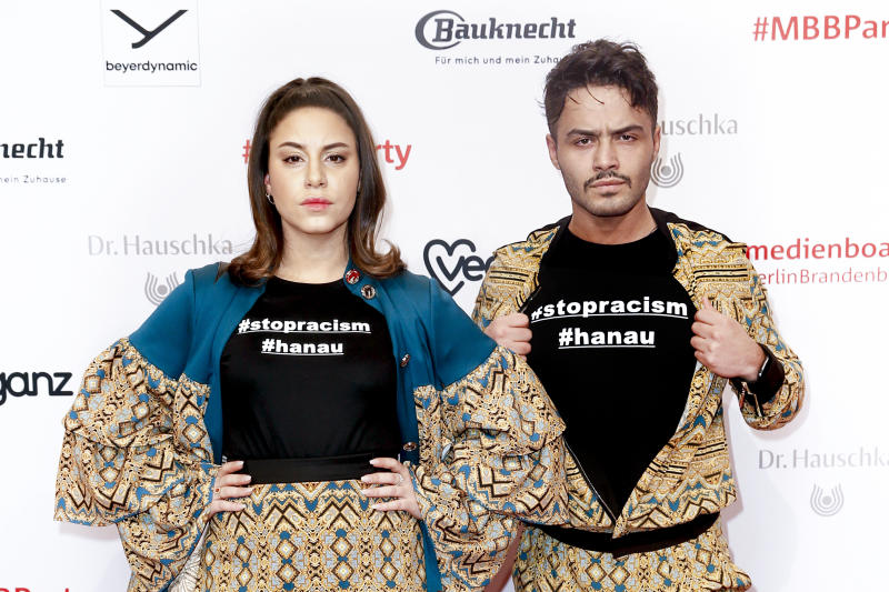 BERLIN, GERMANY - FEBRUARY 22: German actress Almila Bagriacik and German actor Aram Arami giving attention to the Hanau shooting (#stopracism #hanau) at the Medienboard Party on the occasion of the 70th Berlinale International Film Festival at Ritz Carlton on February 22, 2020 in Berlin, Germany. (Photo by Isa Foltin/Getty Images)