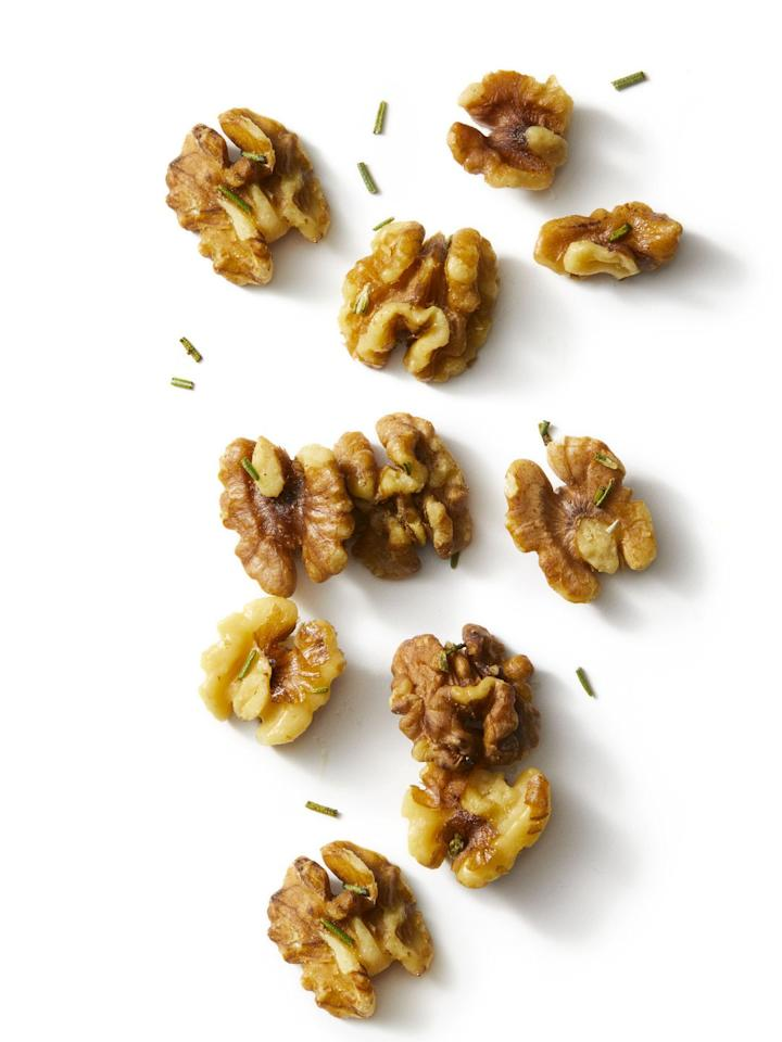<p>Heat oven to 400°F. In a bowl, toss 1 cup of walnuts with 2 tsp olive oil, then toss with 1 tsp finely chopped fresh rosemary and ¼ tsp each salt and pepper. Arrange in a single layer on a rimmed baking sheet and bake until they smell lightly toasted, six to eight minutes. </p><p><em>Serves 2</em></p>
