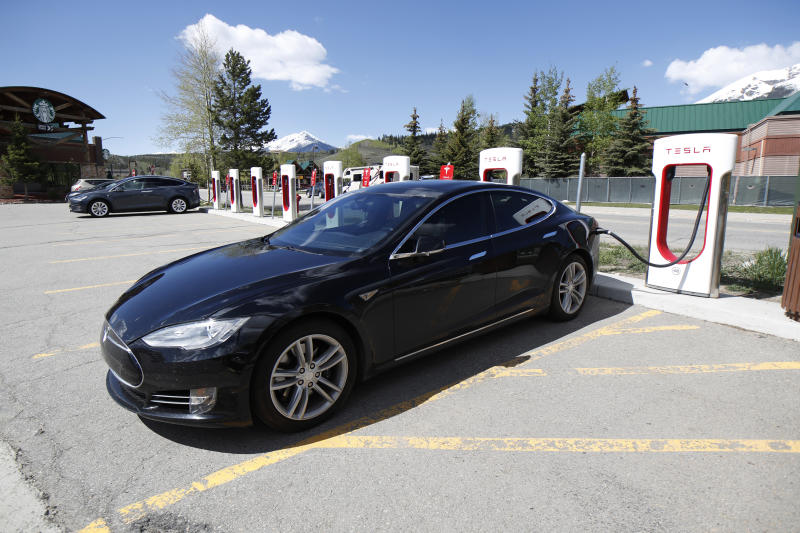 In this Saturday, June 8, 2019, photograph, a Model S sedan charges at a Tesla supercharging station in Silverthorne, Colo. (AP Photo/David Zalubowski)