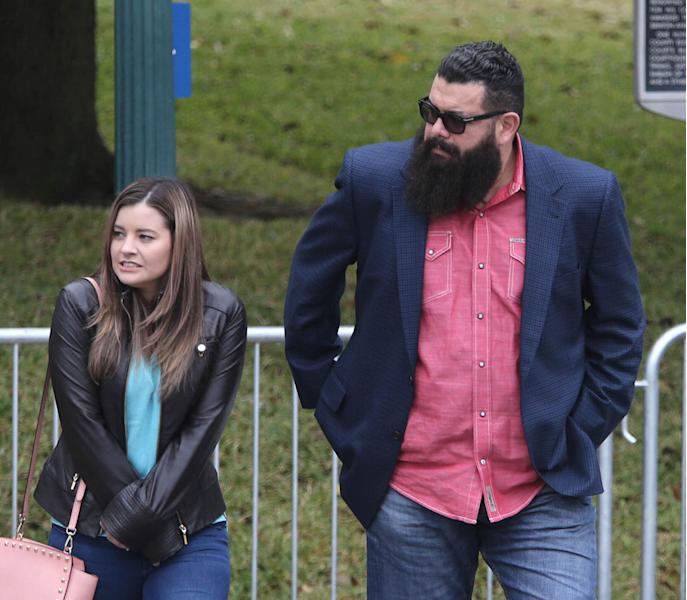 """Christopher """"Jake"""" Carrizal, right, arrives at the McLennan County courthouse with an unidentified women, Thursday, Nov. 9, 2017, in Waco, Texas. A jury started deliberating around noon after both sides of the case presented closing arguments. The Dallas chapter president of the Bandidos motorcycle club is the first to stand trial involving the 2015 shootout where nine people were fatally shot and 18 people were injured outside of Twin Peaks restaurant. (Jerry Larson/Waco Tribune Herald, via AP)"""